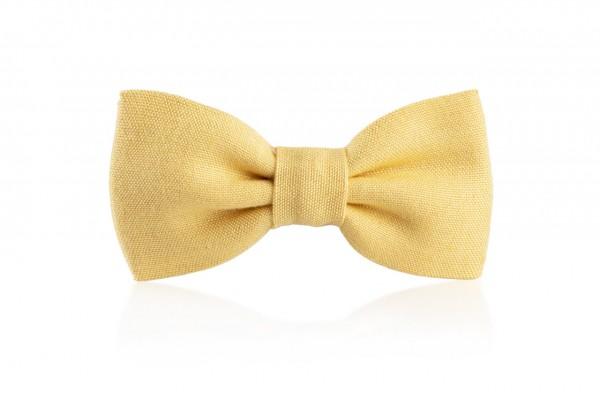 Gelbe Kinderfliege Piccolo Turi aus Leinen